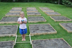 Completed square foot garden boxes, filled with soil, and gridded.